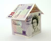 Image of bank notes in the shape of a house